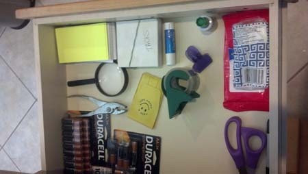 junk drawer clean with magnifying glass